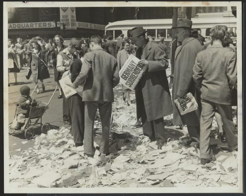 Photograph of people reading newspapers