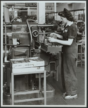 Female worker at lathe in armaments factory