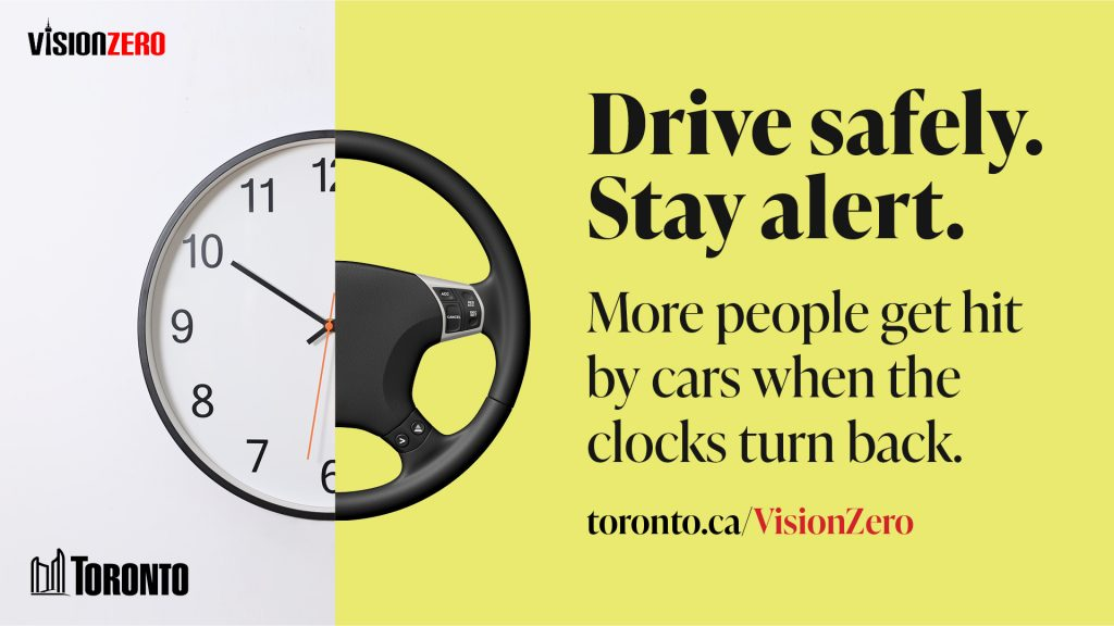 Image of a clock and steering wheel that reads: Drive Safely. Stay Alert. More people get hit by cars when the clock turn back.