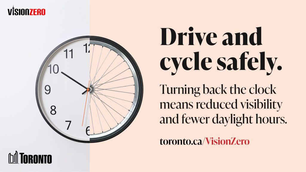Image of a clock and bicycle tire that reads: Drive and cycle safely. Turning back the clocks means reduced visibility and fewer daylight hours.