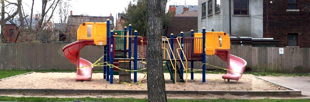 The playground at Melbourne Avenue Parkette, taped off with yellow caution tape due to the COVID-19 pandemic in 2020.