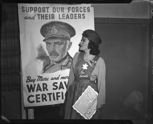 Photograph of woman posing in front of poster
