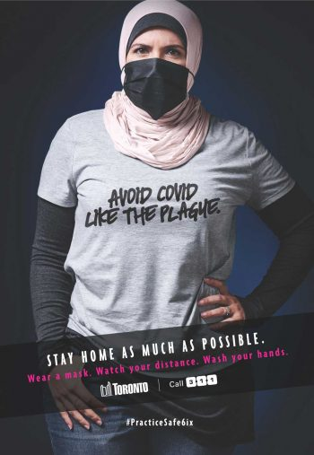 Young woman wearing a t-shirt that states avoid COVID like the plague