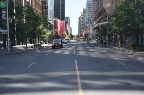 Image of Bloor Street before the bike lane installation with four lanes of traffic.