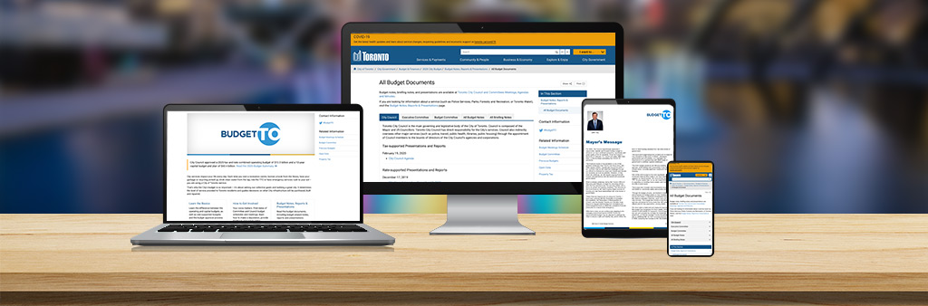 Computer, laptop, tablet and phone with information on the City of Toronto budget