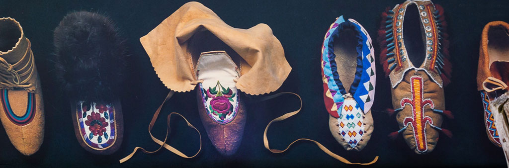 A poster with various Indigenous moccasins