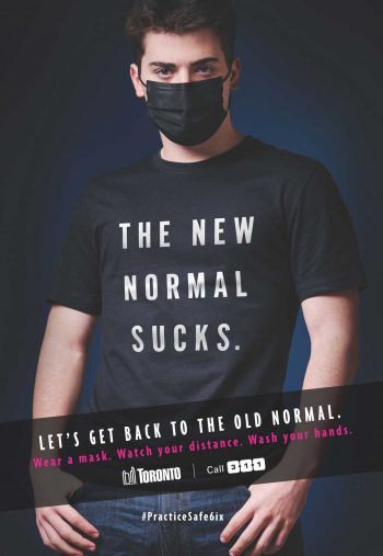 Young man wearing a t-shirt that state the new normal sucks