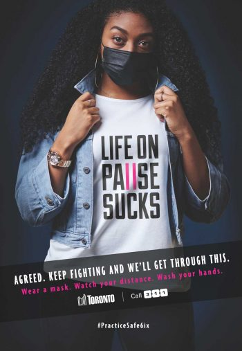 Young woman wearing a t-shirt with text that says life on pause sucks