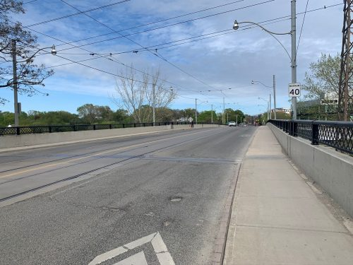 Image of Dundas Street before the bike lane installation with four lanes of traffic.