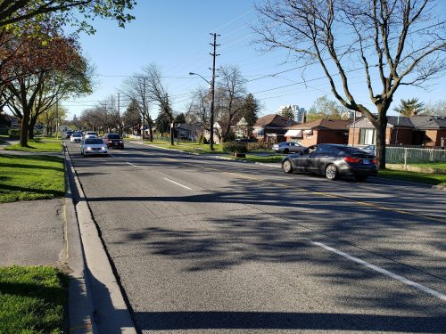 Image of Brimley Road before the bike lane installation with four lanes of traffic.