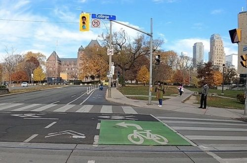 Image of University Avenue after the bike lane installation with painted bike lanes separated by bollards