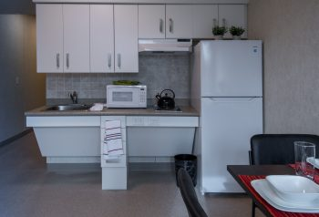 kitchen in 11 Macey Ave unit. Includes microwave, stove, kettle, and fridge.