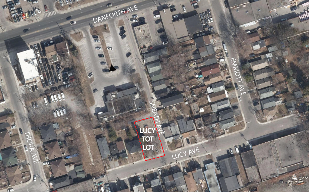 An aerial overview of the Lucy Tot Lot site, indicated by a red border. The playground is located at 2 Sneath Avenue near Danforth and Emmott Avenue.
