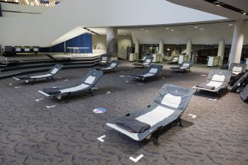 cots in the scarborough civic centre warming centre. Each bed has a blanket.
