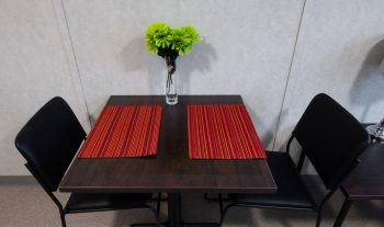 321 Dovercourt Rd. dinning table with 2 chairs and placemats.