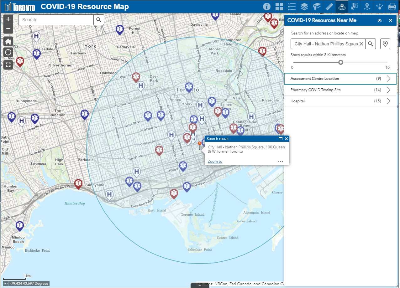 Display of Map zoomed to City Hall with a buffer circle around it for 5 km in all directions - as well show the COVID-19 Resources Near Me menu with the number of Assessment Centre locations that fall within the buffer showing (9) - same for COVID testing sites(14) and Hospital.(15)