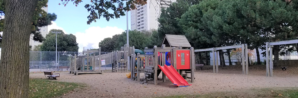 Playground equipment at Roywood Park. There are slides, swings and other climbing equipment.