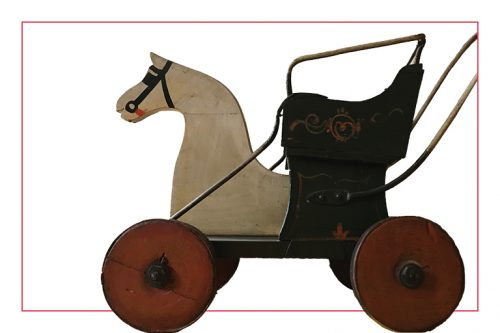 A wooden stroller with horse-drawn carriages typical of the period