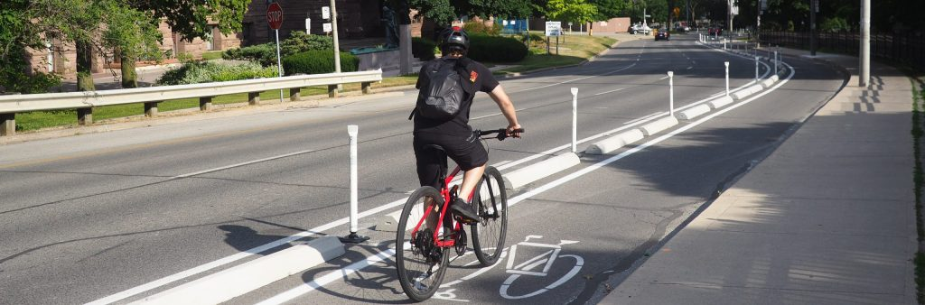 image of a man on the University Cycle tracks that show 2 lanes of traffic.