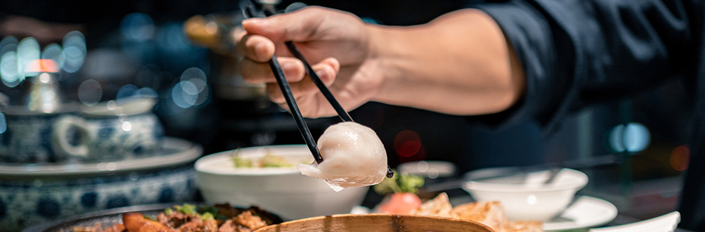 Image of food being held with chopsticks.