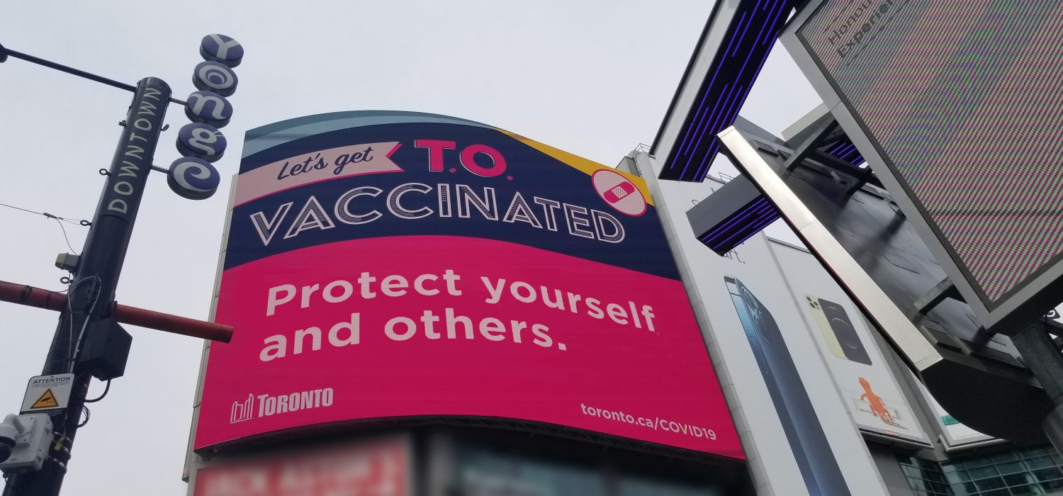 Let's Get Vaccinated Toronto Ad Campaign at Yonge Dundas Square