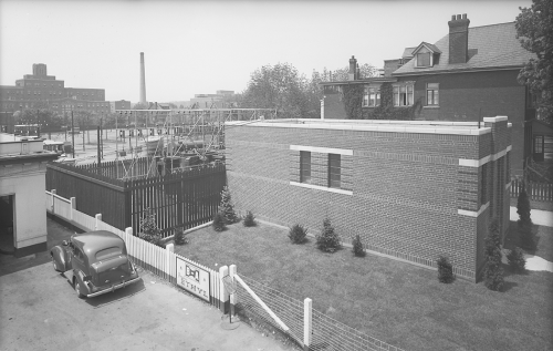 One story brick building with transformer yard in the backyard.