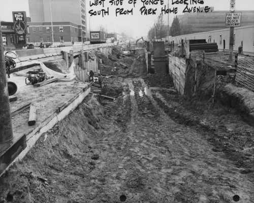 Large muddy trench excavated on Yonge Street.