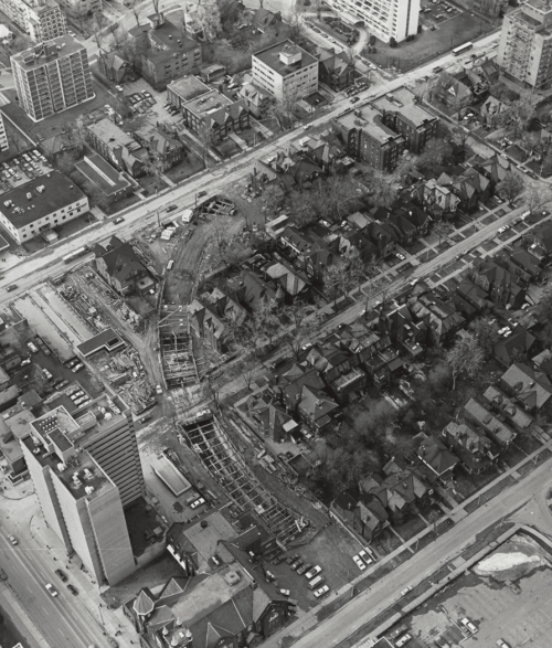 Aerial view showing construction of tunnel and surrounded by apartment buildings and houses