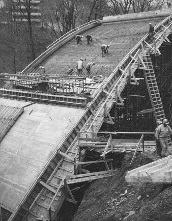 Men working on installation of bridge supports.