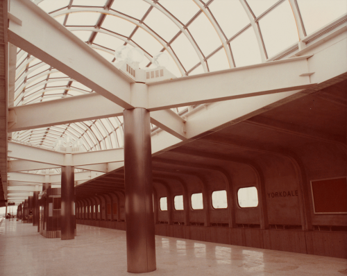 Looking along platform showing pillars and glass domed roof