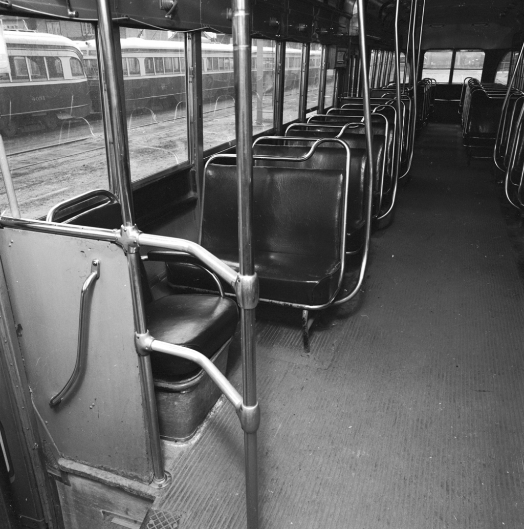 Interior of empty streetcar.