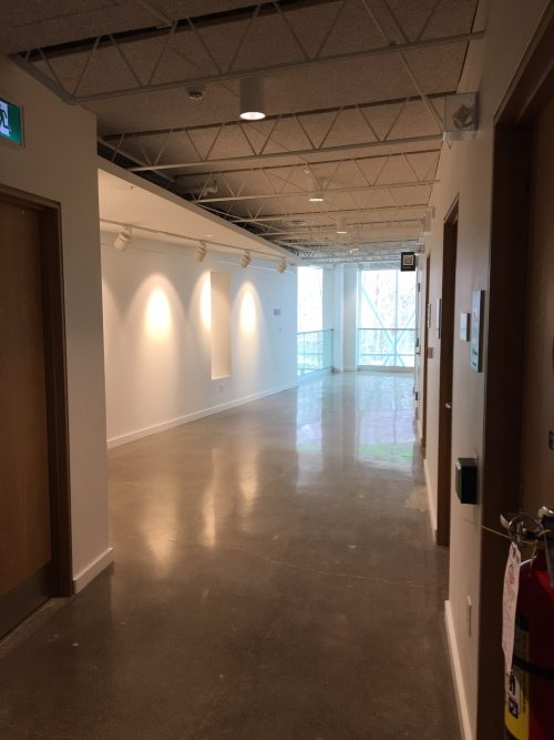 Image depicts view from inside 2nd floor gallery corridor, looking north