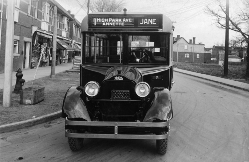 """Front of a bus with a front that looks like an old-fashioned truck. The sign reads """"High Park Ave., Annette, Jane.:"""