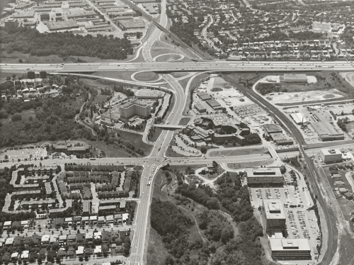 Major roadways and highway with subdivisions and hospital in the foreground.