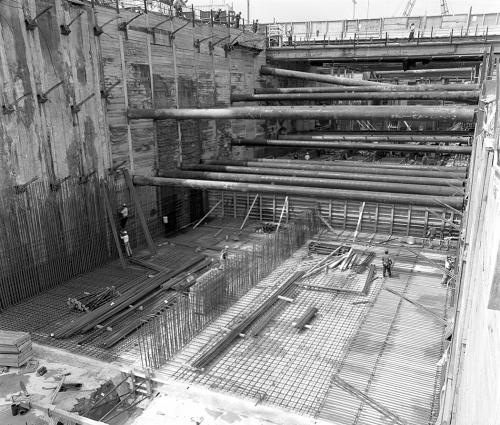 Installation of rebar along wall. Horizonal beams have been installed at two levels.