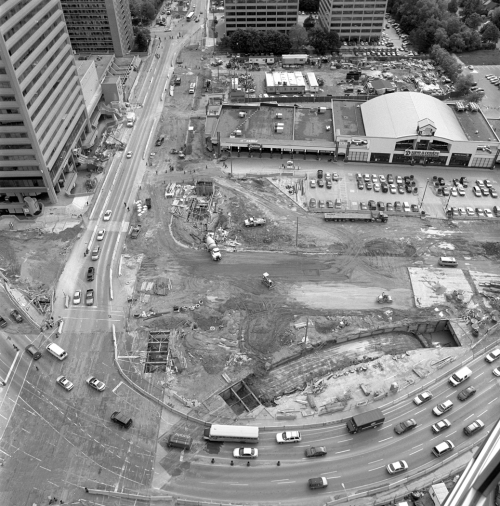 Construction if foreground. Background showing shopping centre and office towers.