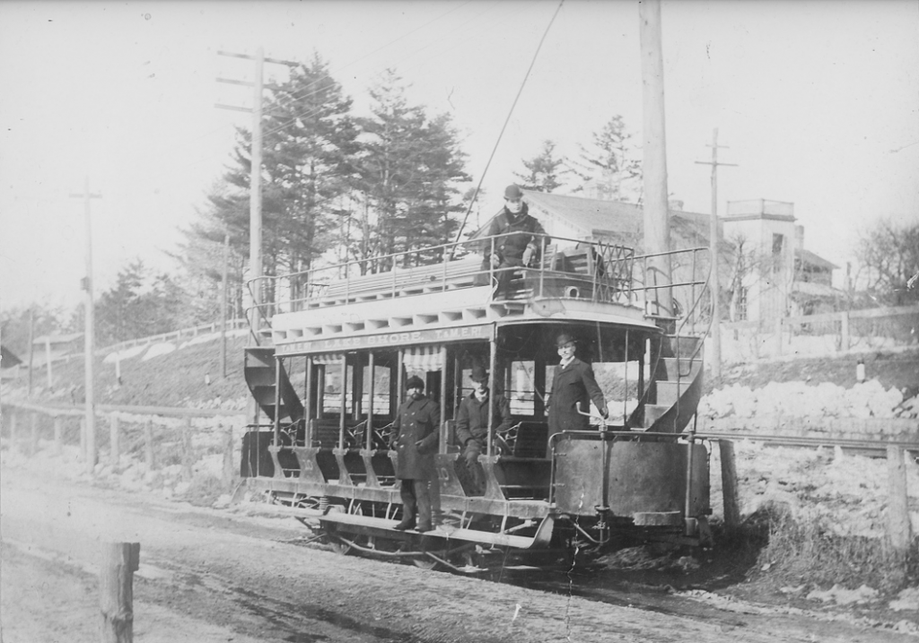 A double-decker streetcar with curving staircases at each end.