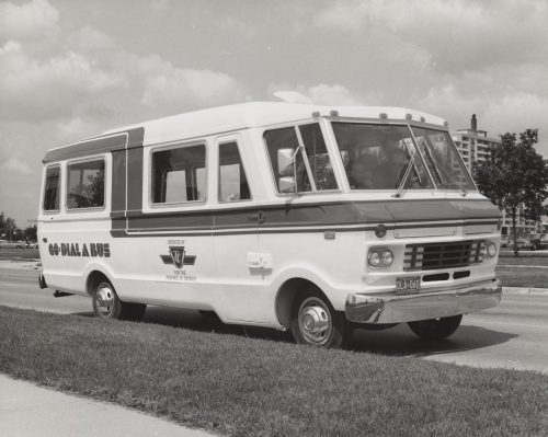 """A large van with """"Go dial a bus"""" and the TTC logo on the side."""