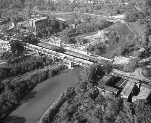 Bridge and construction of subway bridge over river.