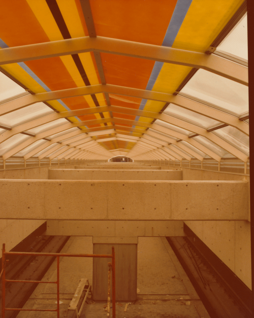 Architectural finishing of platform and coloured panel artwork along ceiling.