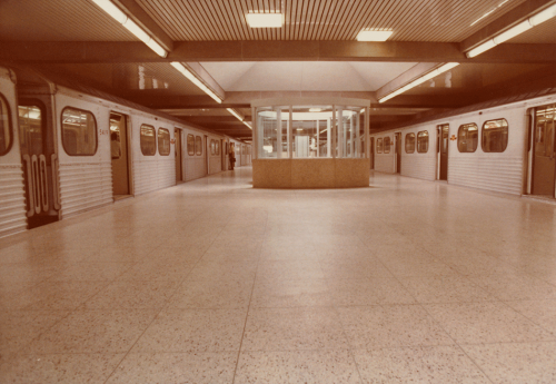 Subway platform with subway trains on either side