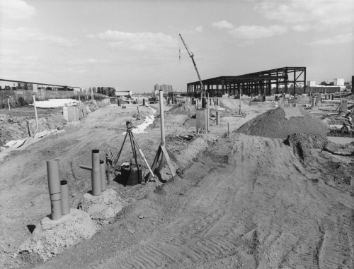 Excavated yard with structure of carhouse erected in the background.