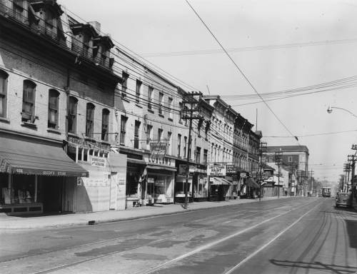 A line of three-storey brick buildings with stores on the first floor, including a Loblaws grocery.