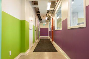 green and purple brightly lit hallway