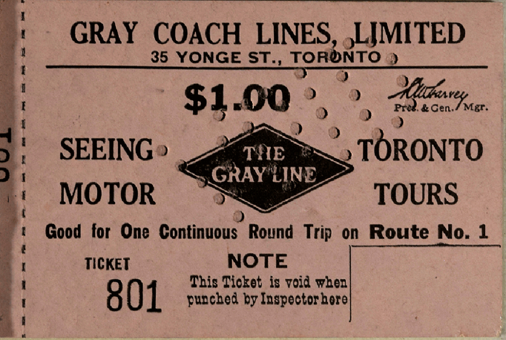 Pink paper bus ticket with black writing and perforated stamp