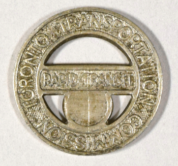 Photograph of a metal Toronto Transit Commission token