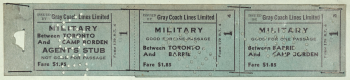 Two green paper bus tickets with black writing and perforated stamp
