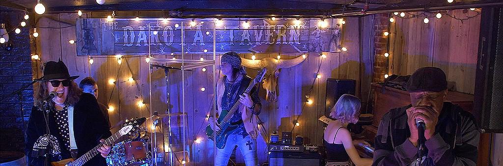 Image depicts band playing at the Dakota tavern