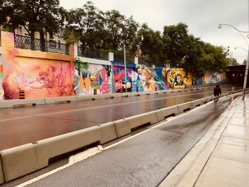 colourful painted murals on the concrete wall of the Lansdowne Underpass