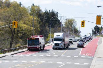 Bus using RapidTO bus lane at traffic light.